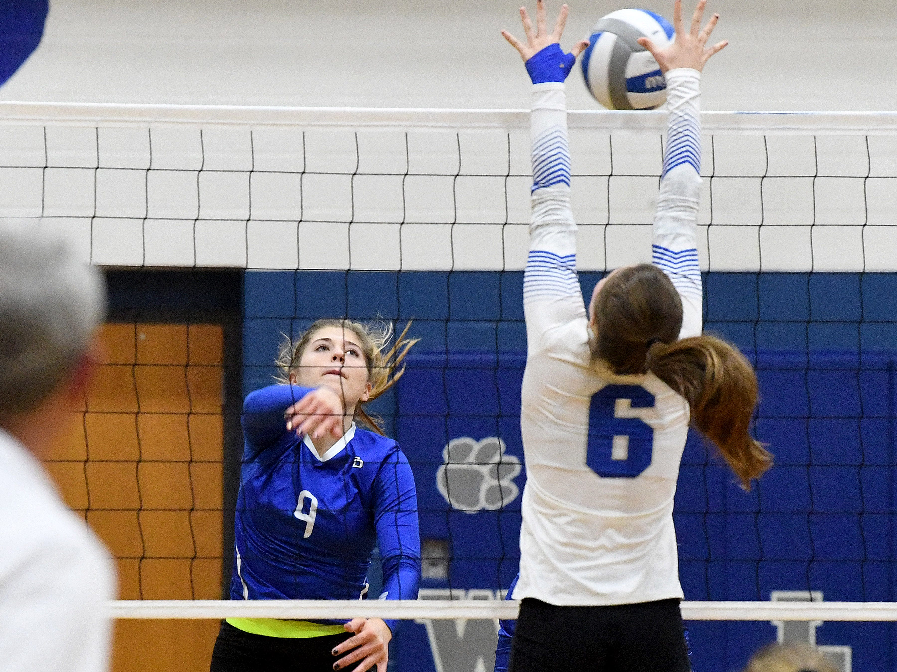 Fort Defiance's Jessi Hull spikes the ball past Rockbridge County's Jaydyn Clemmer during a Region 3C semifinal match played in Lexington on Monday, Nov. 5, 2018.
