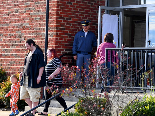 Cadet 1st Lt. Jack Clegg opens the door for a voters coming and going at the Ward C polling place at the Wayne Hills Center in Waynesboro on Election Day, Tuesday, Nov. 6, 2018.