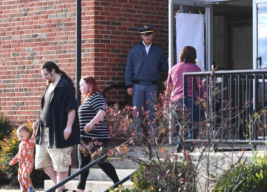 Cadet 1st Lt. Jack Clegg opens the door for a voters in. Waynesboro.