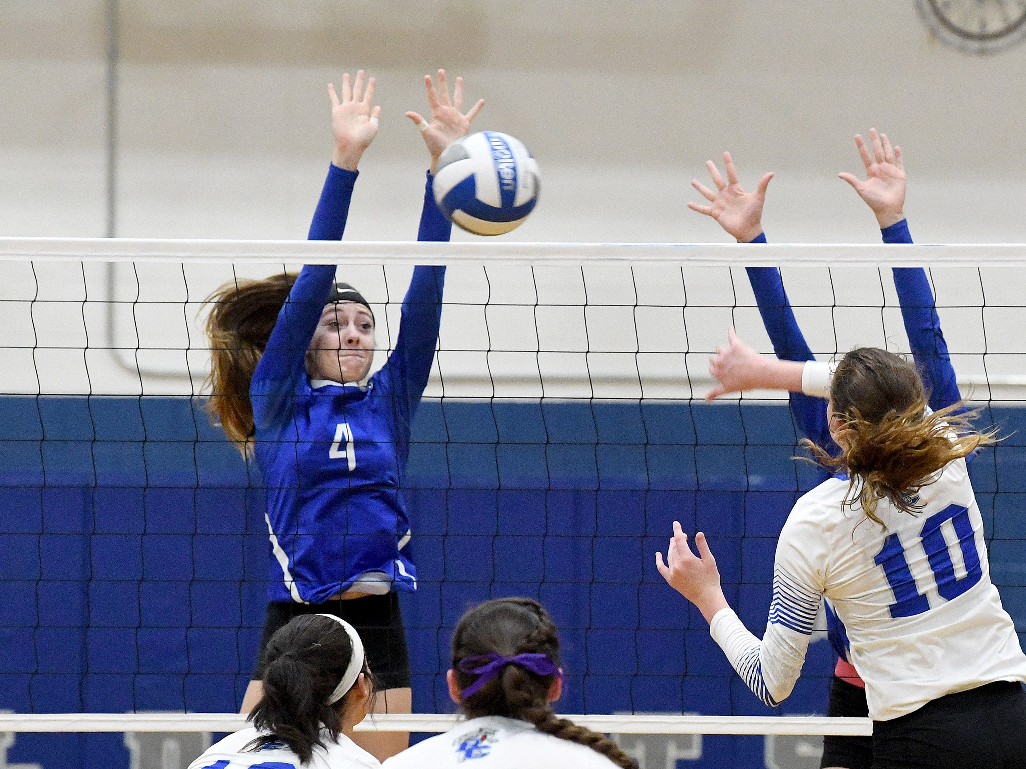 Fort Defiance's Leilani Goggin blocks a return by Rockbridge County's Kriston Whitesell during a Region 3C semifinal match played in Lexington on Monday, Nov. 5, 2018.