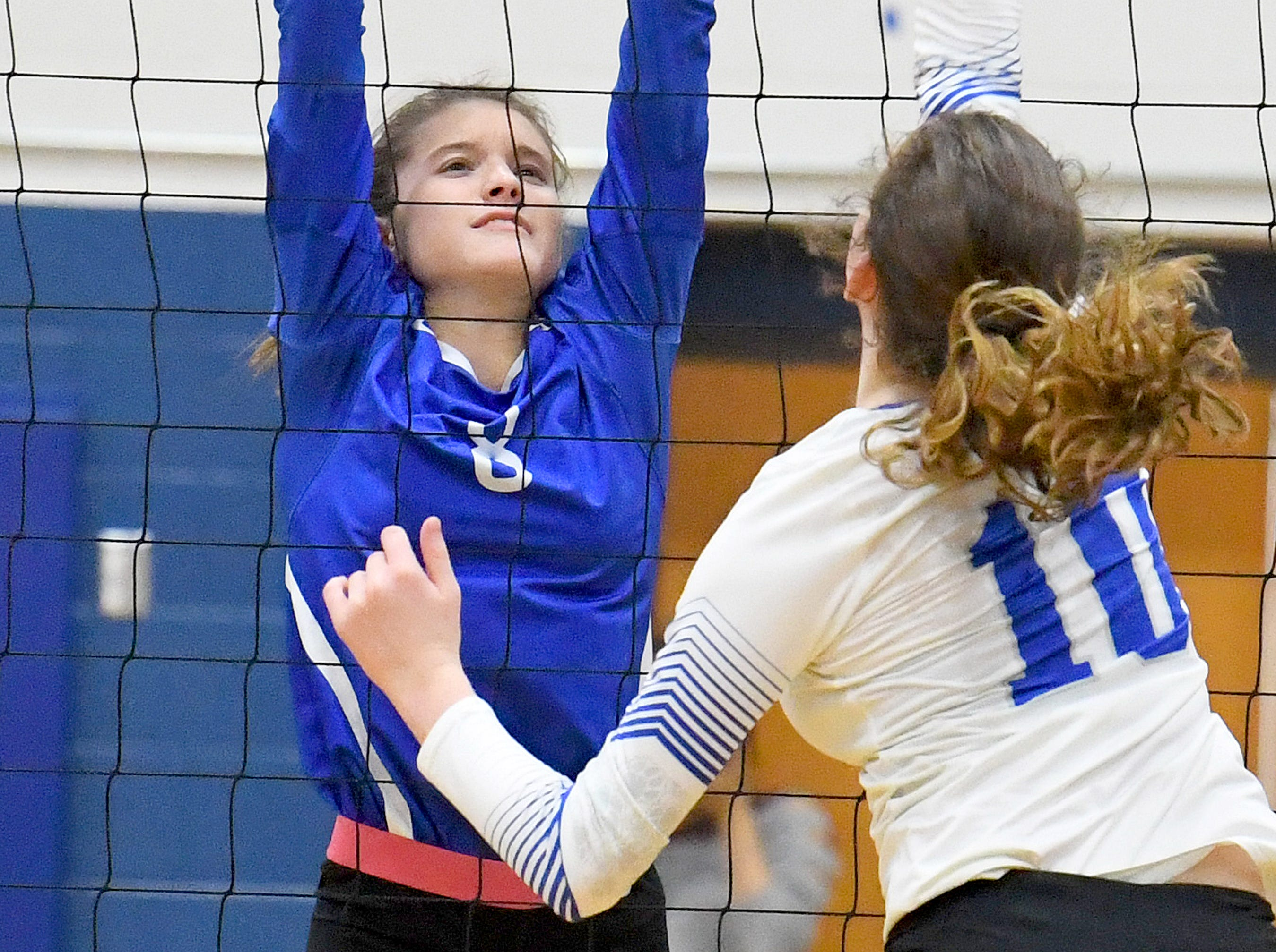 Fort Defiance's Casey Mozingo tries to block a return at the net during a Region 3C semifinal match played in Lexington on Monday, Nov. 5, 2018.