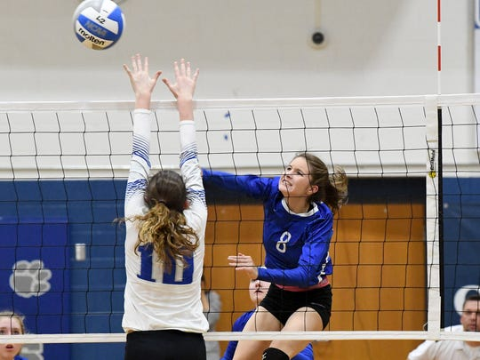 Fort Defiance's Casey Mozingo spikes the ball past Rockbridge County's Kriston Whitesell during a Region 3C semifinal match played in Lexington on Monday, Nov. 5, 2018.