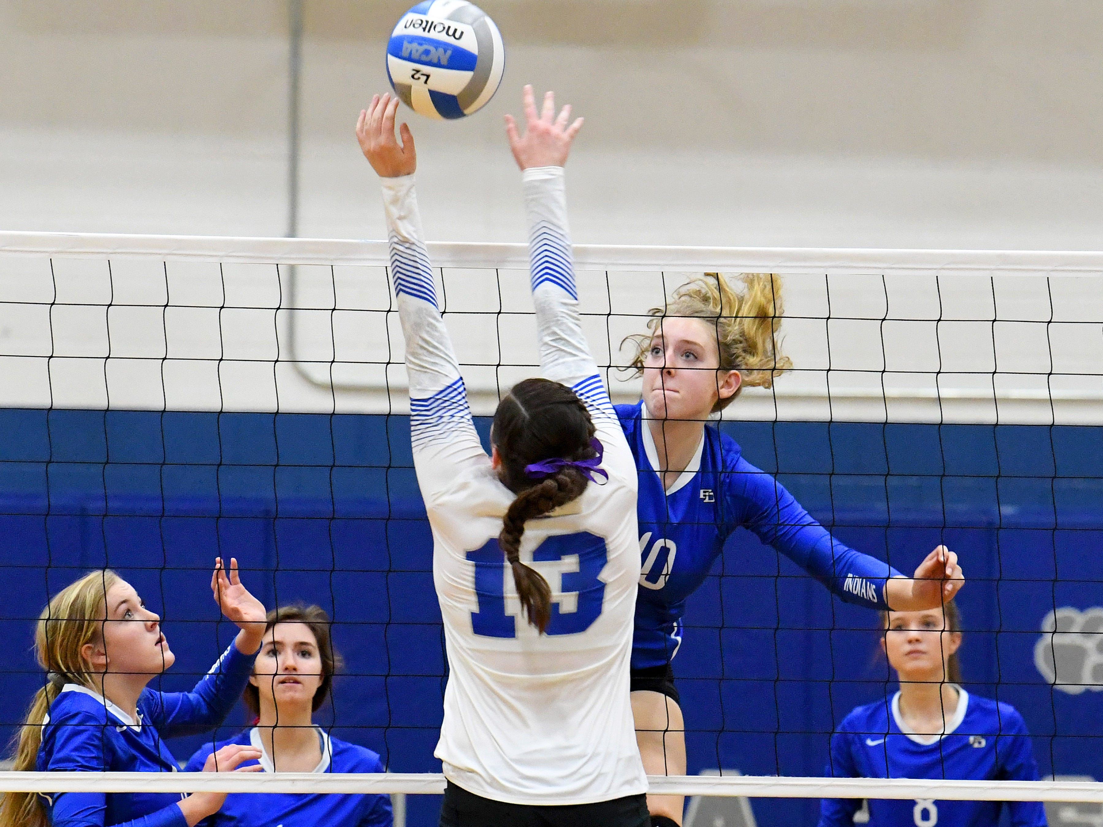 Fort Defiance's Catie Cramer hits the ball past Rockbridge County's Graceon Armstrong during a Region 3C semifinal match played in Lexington on Monday, Nov. 5, 2018.
