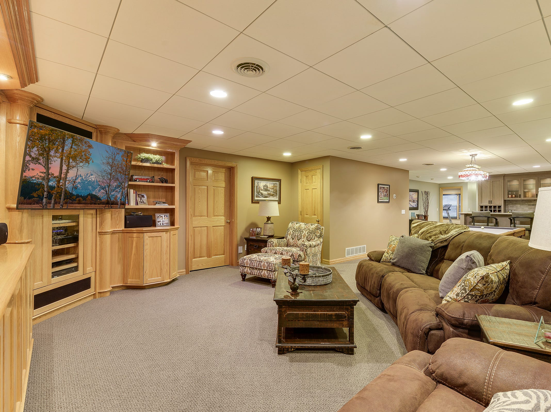 The lower level features a large family room with plenty of built-in bookshelves and storage.