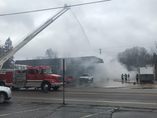 Sartell fire crews worked to extinguish a blaze Tuesday, Nov. 6, at Fouquette Auto in Sartell.