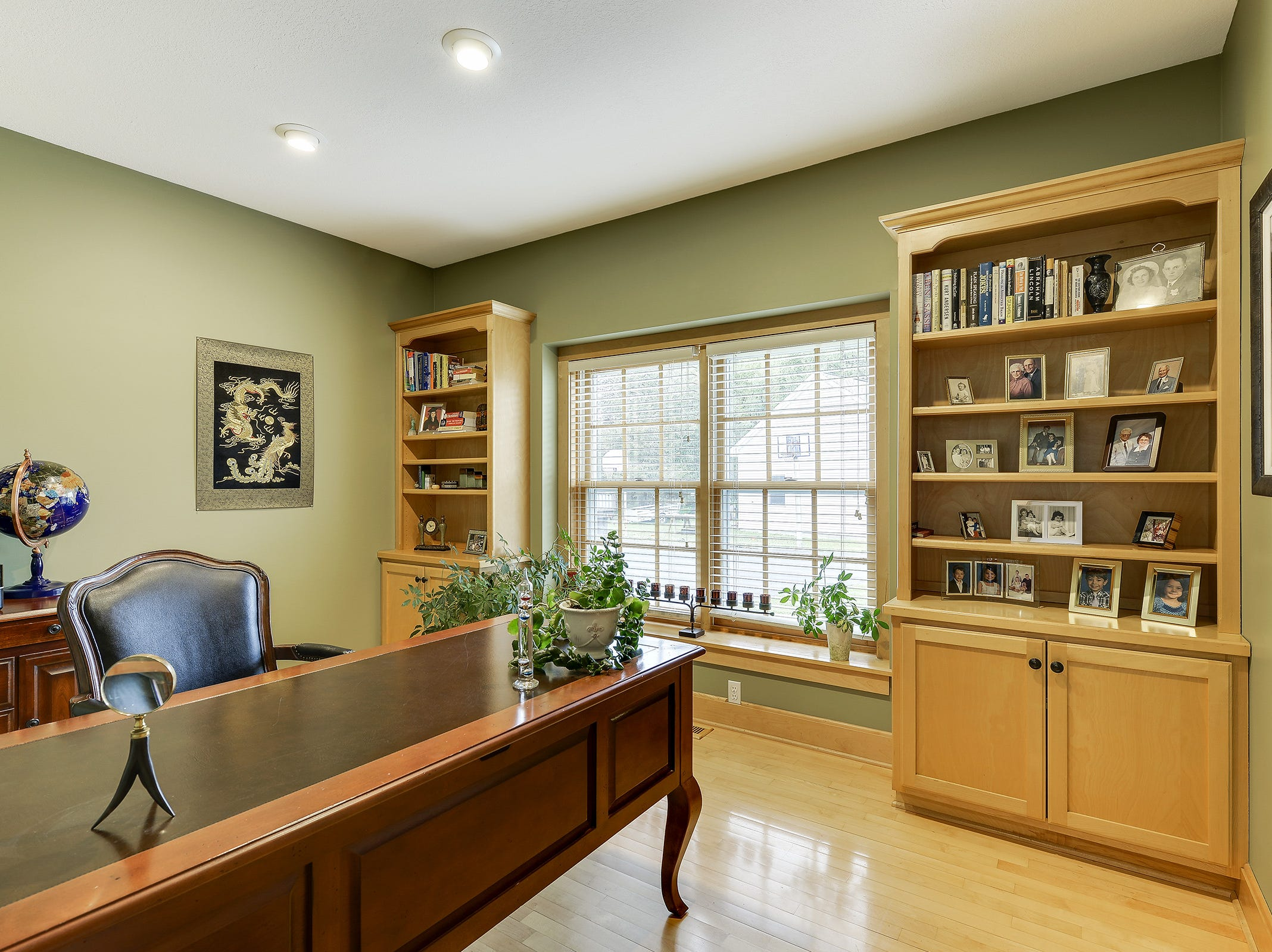 The main floor houses an in-home office with wood floors and built-in bookshelves.