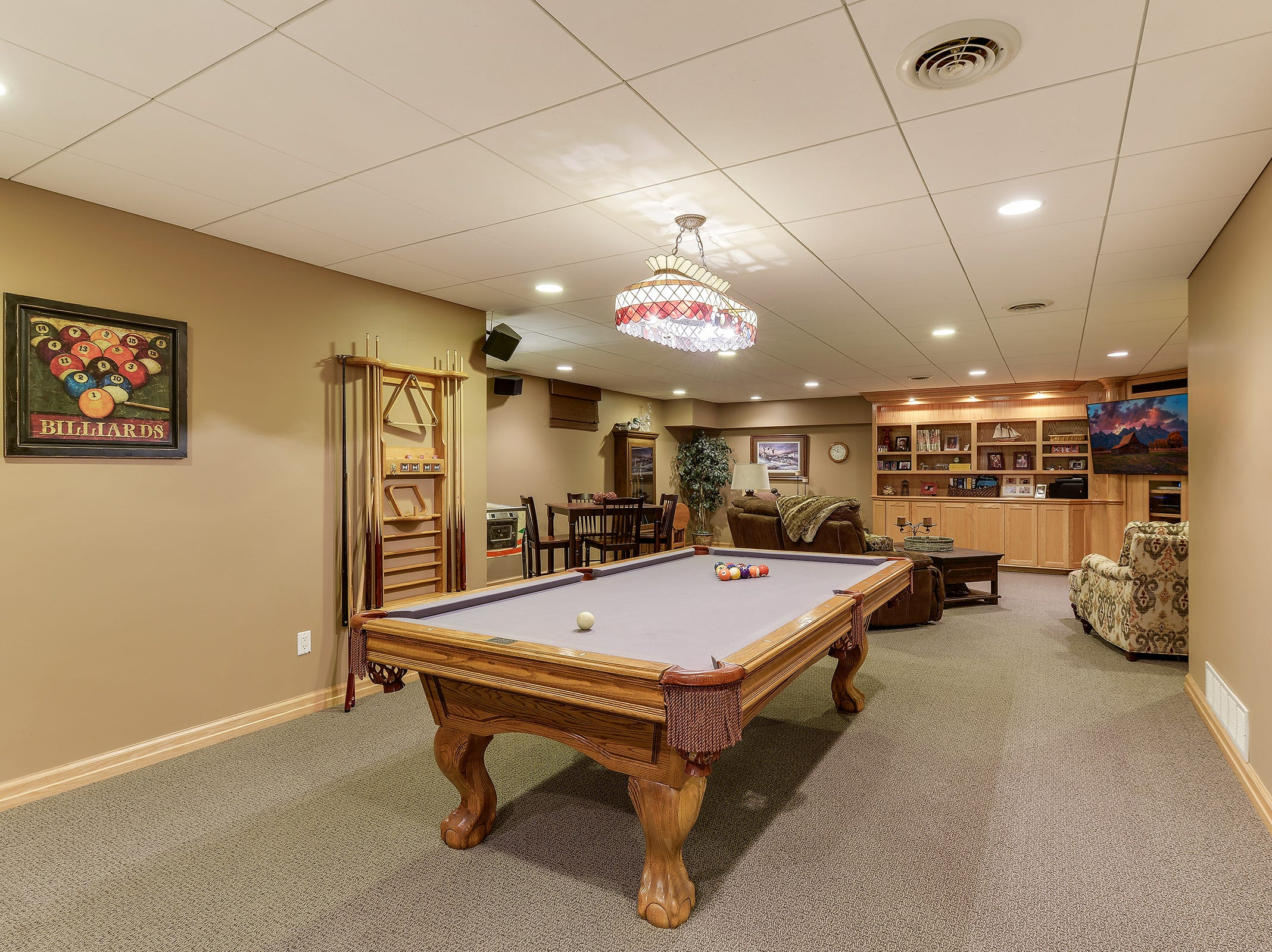 The lower level features a large family room with plenty of built-in bookshelves and storage, a billiards area and a new wet bar.