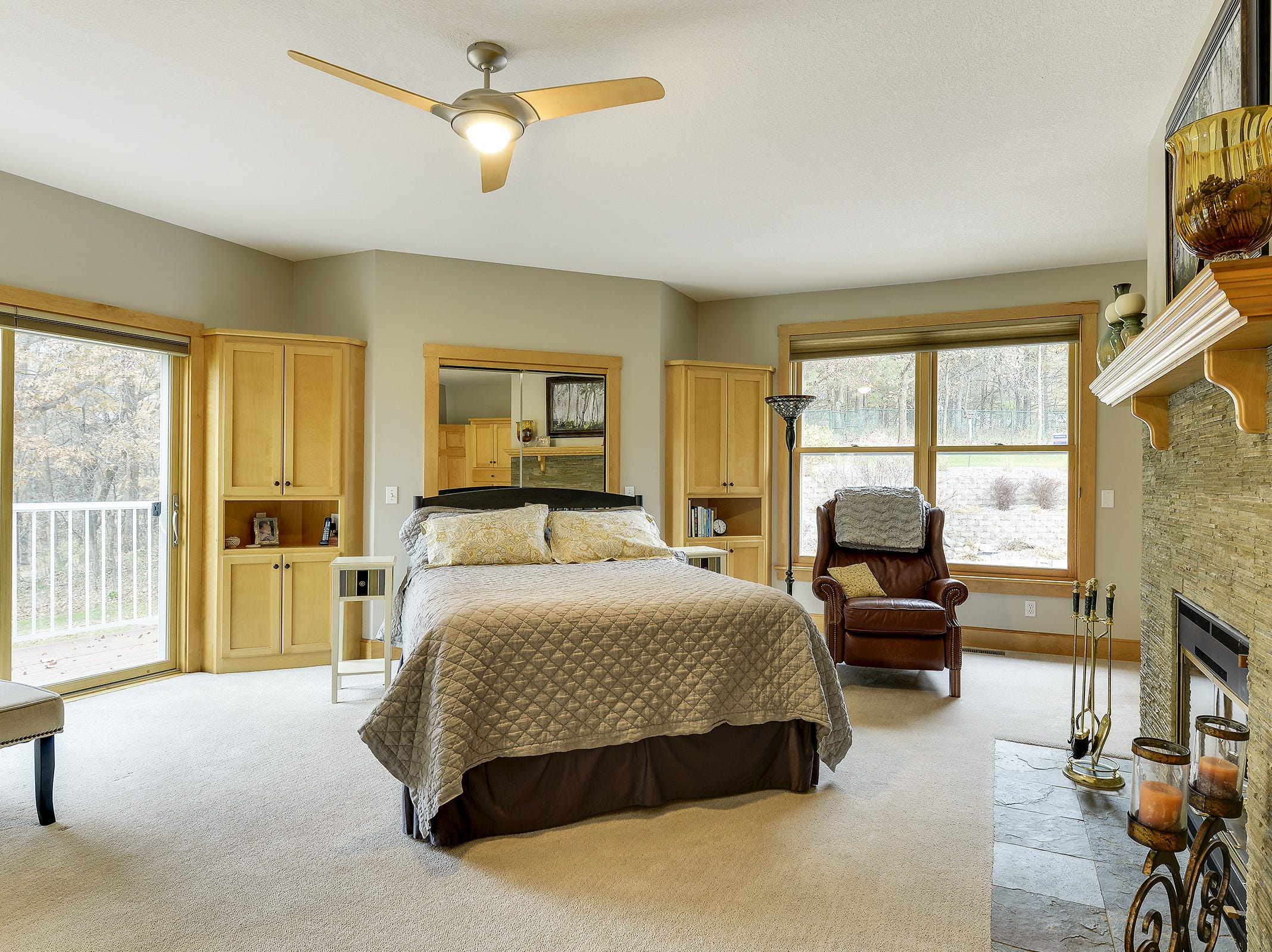 The master suite has been renovated with a stone fireplace that adds ambiance and warmth to the room.