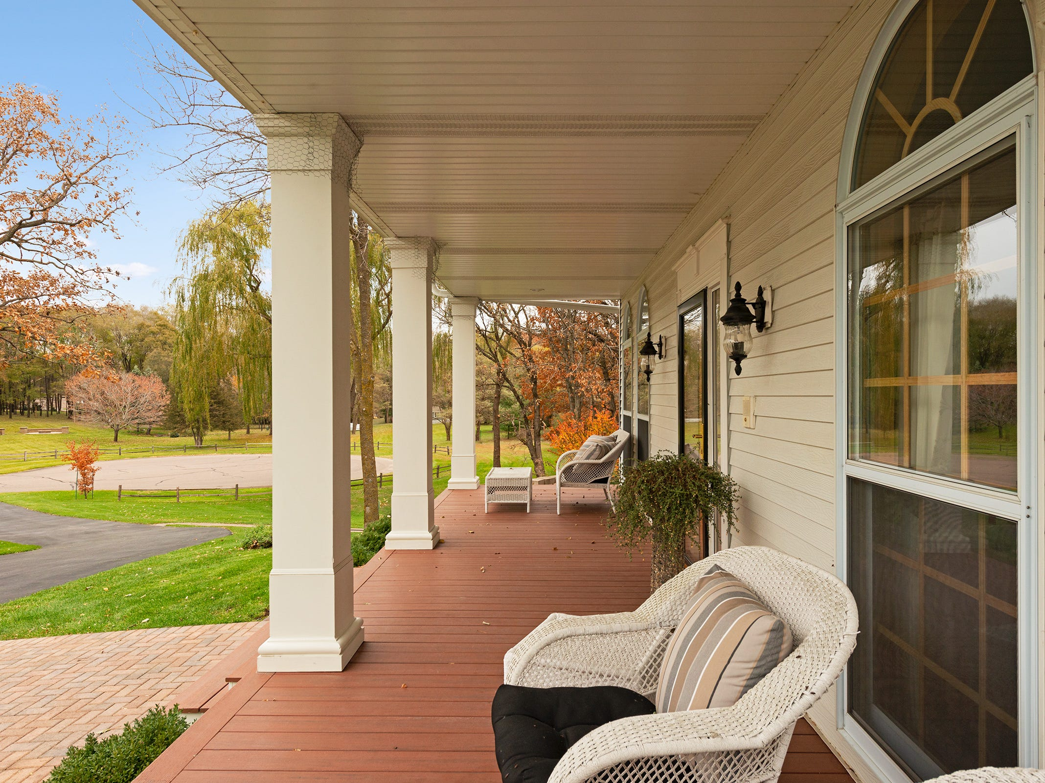 The expansive front porch of this more than 5,200-square-foot home beckons family and friends to stop and relax for a while.