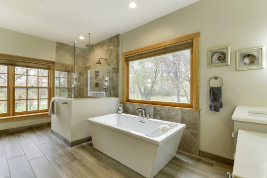 Just off the master is the en suite, which is beautifully renovated with an angular soaking tub and a standalone glass rain shower.