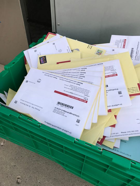 Ballots that Washington County voters have dropped off fill a basket on Election Day, Nov. 6, 2018, in St. George.