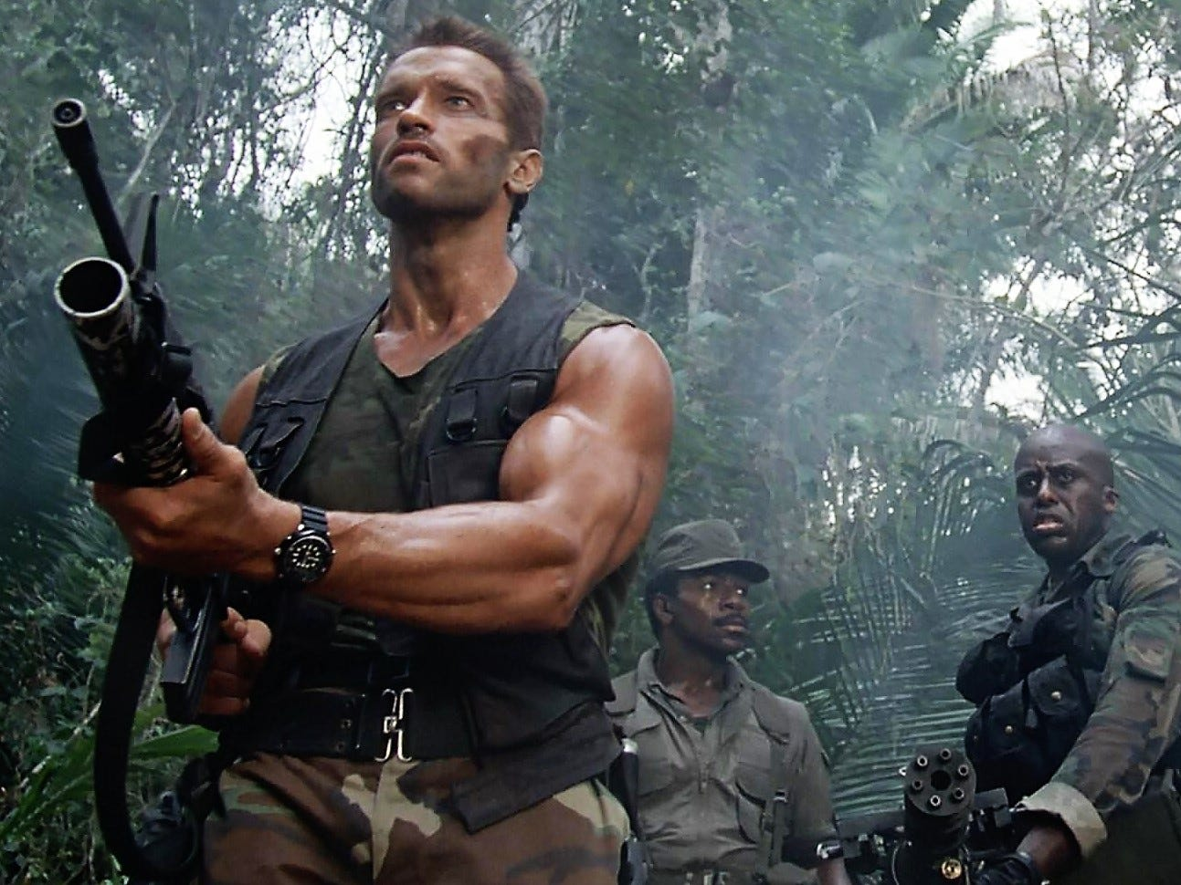 "Arnold Schwarzenegger (left), Carl Weathers and Bill Duke portray men facing an alien in the movie ""Predator."""