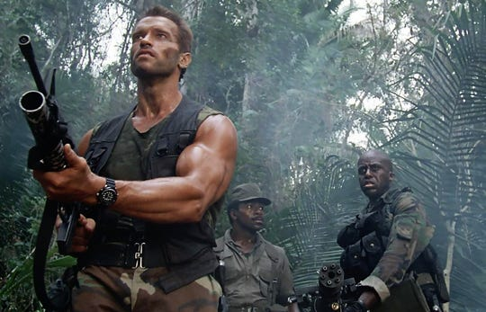 "Arnold Schwarzenegger (left), Carl Weathers and Bill Duke portray men facing an alien in the movie ""Predator."""