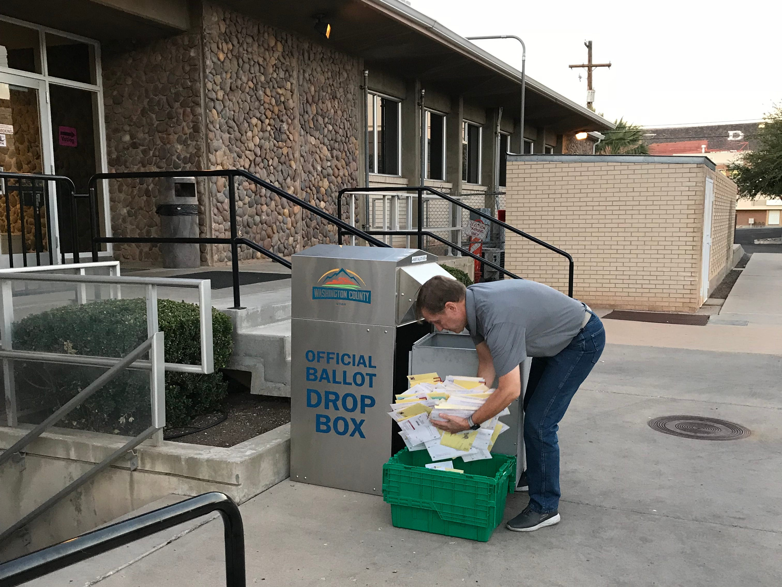Jerry Rasmussen, deputy auditor for Washington County, collects ballots at the County Administration office in St. George early on Election Day 2018.