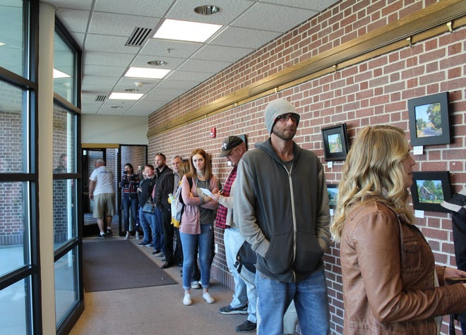 Voters choosing to drop off mail-in ballots Election Day wait in line at Cedar City Hall November 6, 2018.