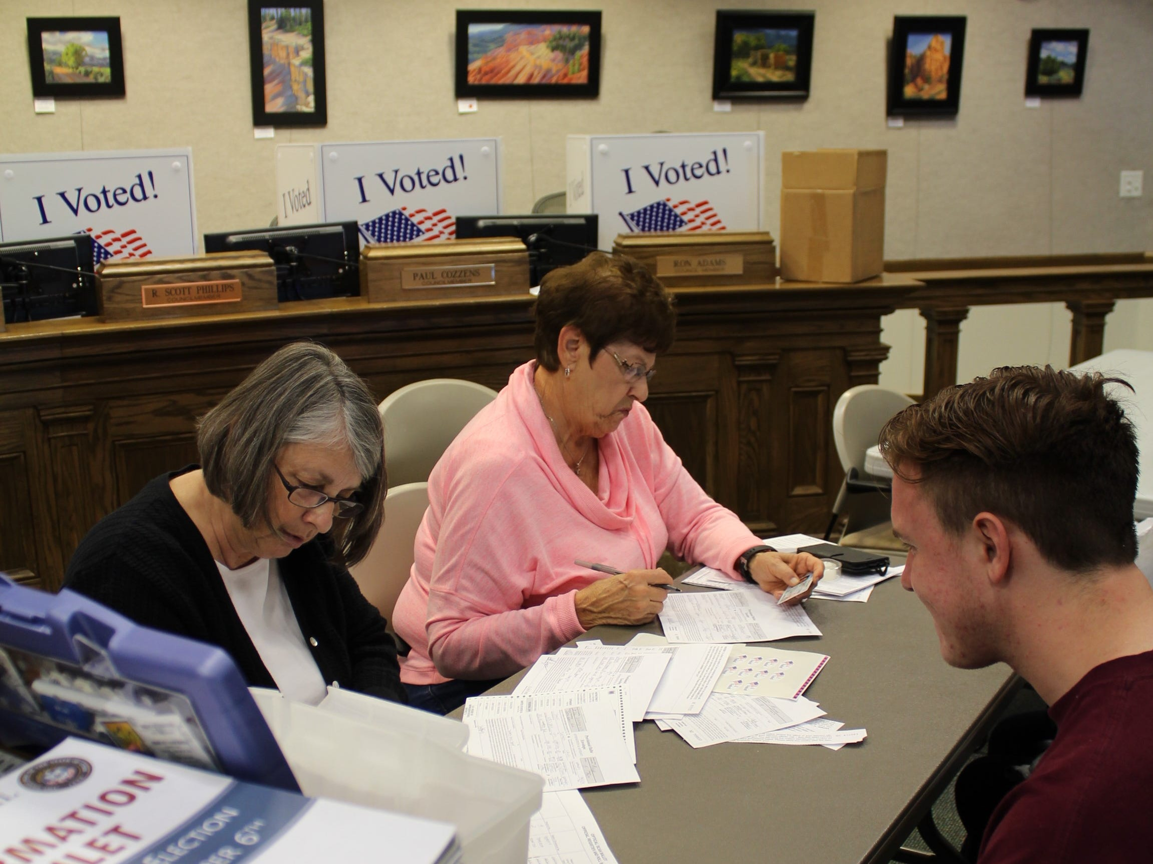 Sam Creamer and Rea Church concentrate on processing dozens of voters Election Day at Cedar City Hall November 6, 2018.