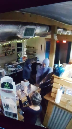 Two men are wanted in connection with the armed robbery of a Wakulla cannabis shop on Monday