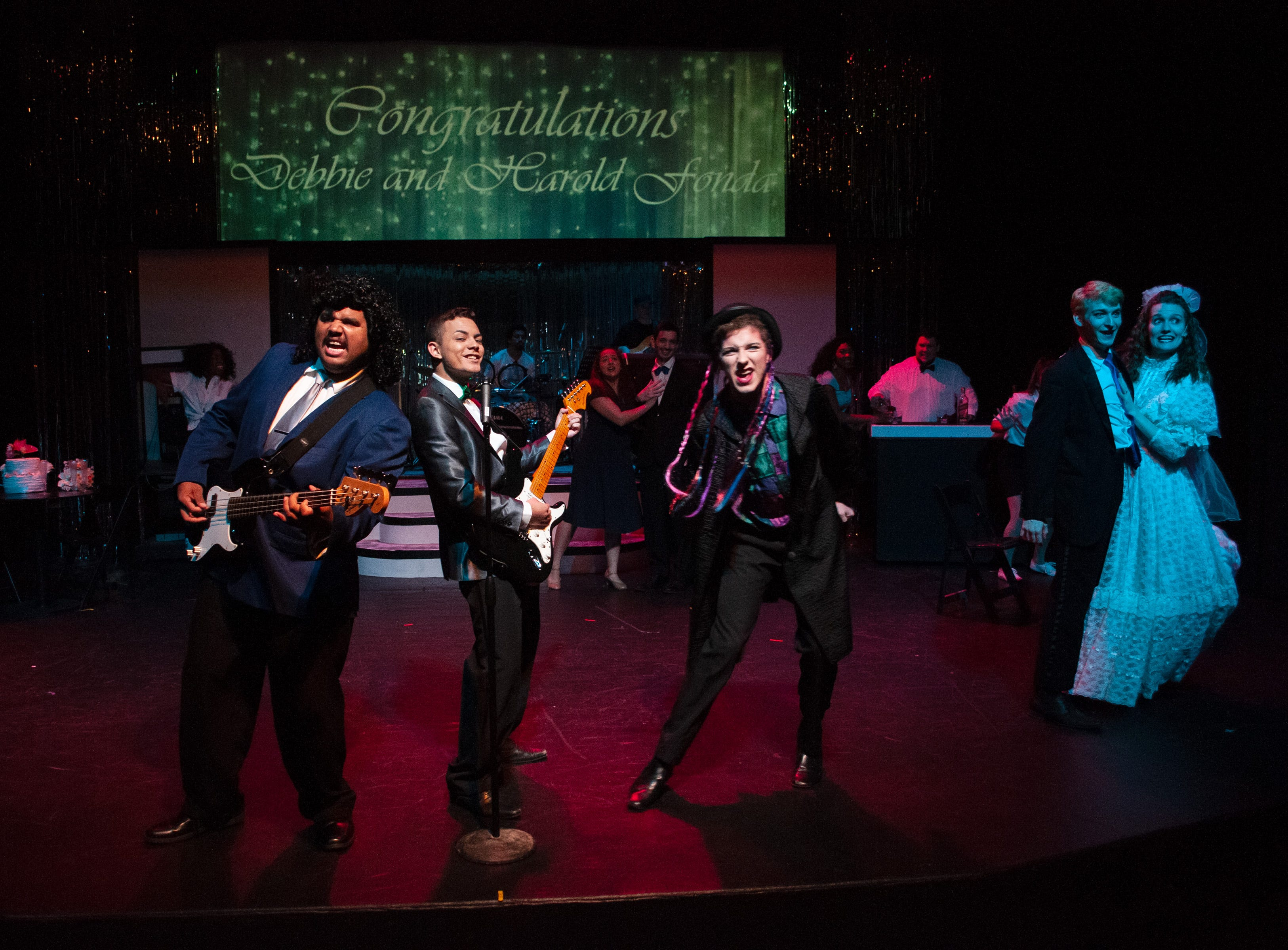 "Robbie's Band plays at a wedding in Theatre Tallahassee's production of ""The Wedding Singer.""Band members: Sammy (Charles Burden), Robbie (Santos Sanchez) and George (Spencer Lail)."