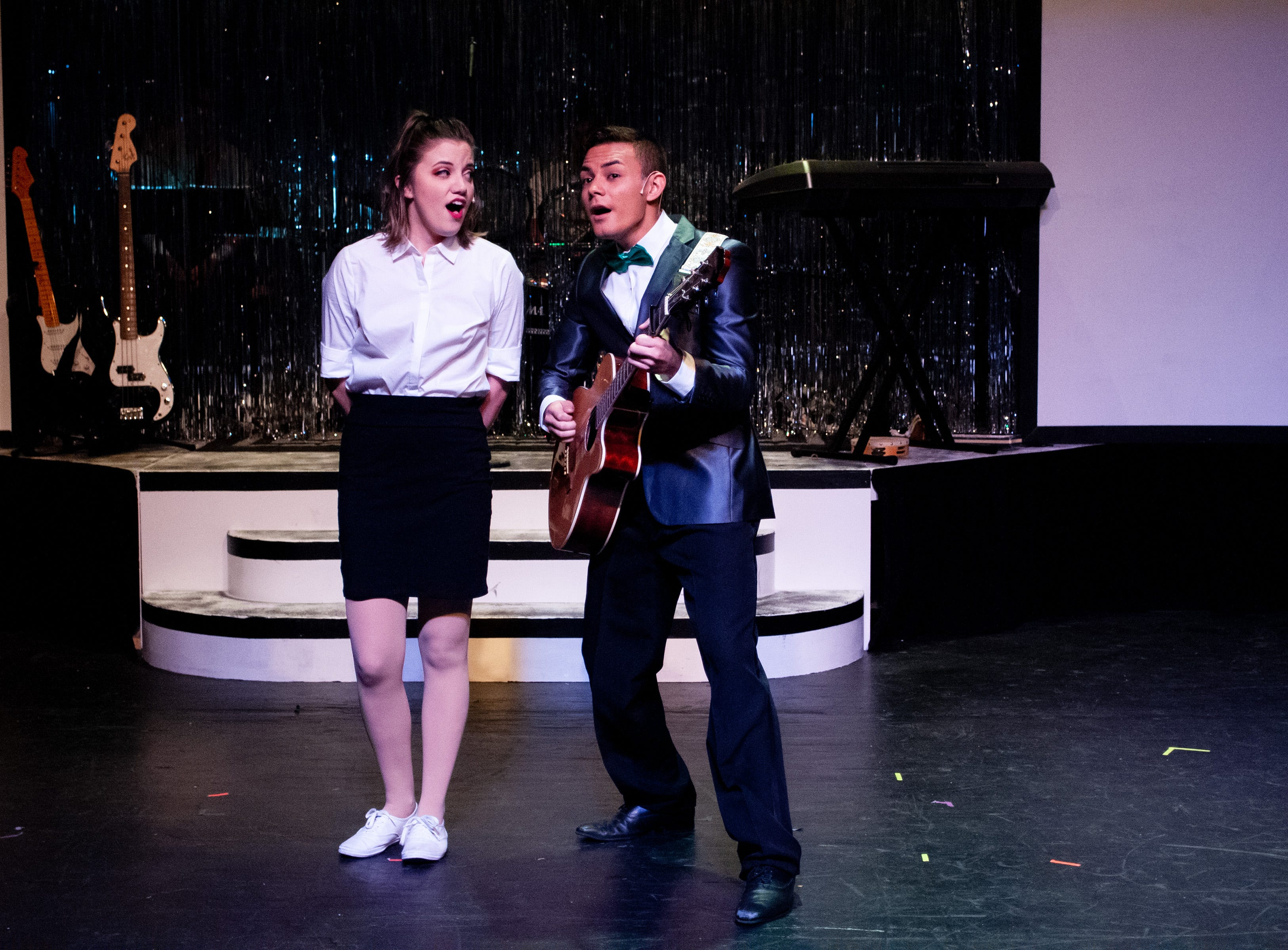 "Julia (Malia Sylvester) helps Robbie (Santos Sanchez) with a new song he's written in Theatre Tallahassee's production of ""The Wedding Singer."""