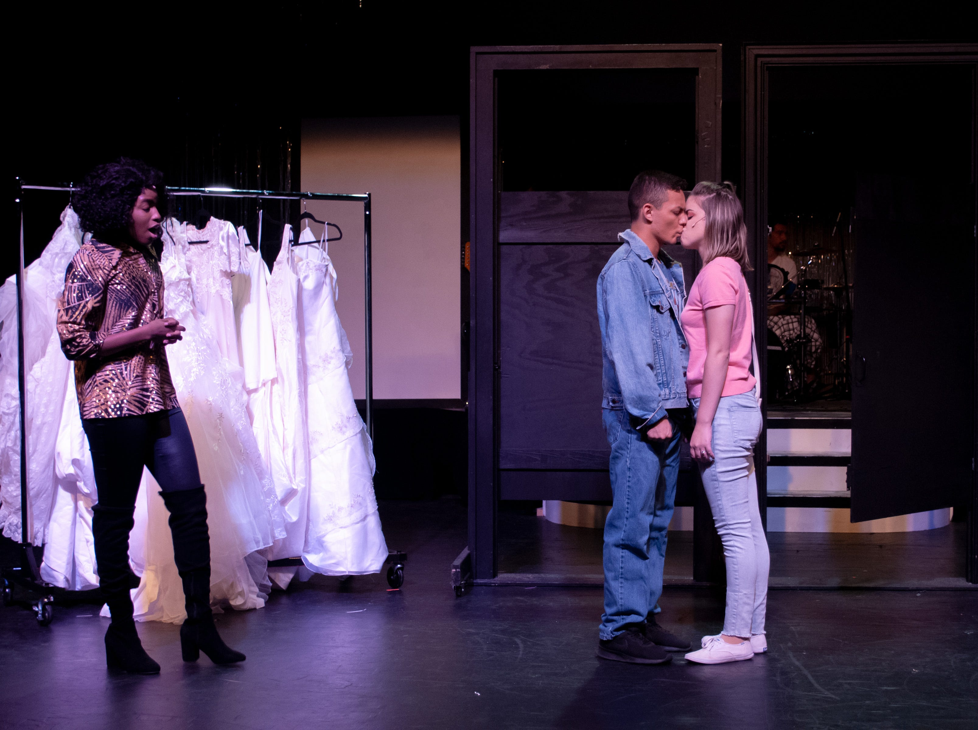 "Holly (Alexis Johnson) looks on in shock as Robbie (Santos Sanchez) and Julia (Malia Sylvester) demonstrate a ""church"" kiss in Theatre Tallahassee's production of ""The Wedding Singer."""