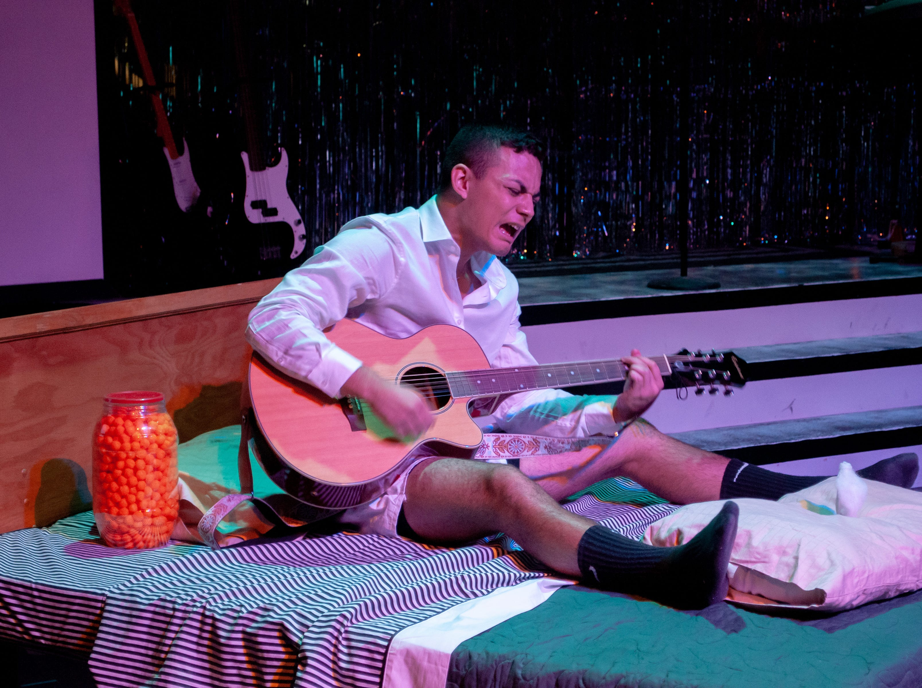 "Robbie (Santos Sanchez) does not deal well with his break up in Theatre Tallahassee's production of ""The Wedding Singer."""
