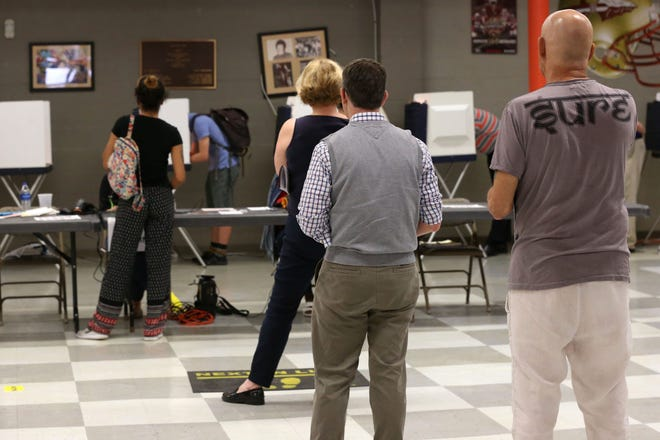 Voters throughout the Tallahassee community use their lunch hour to vote at the Lafayette Community Center for the midterm elections on Election Day, Nov. 6, 2018.