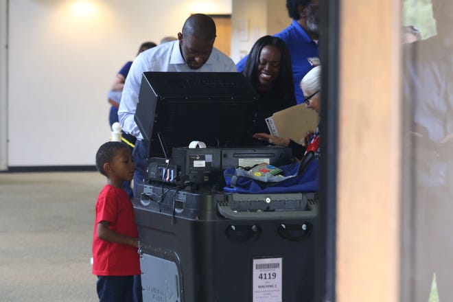 Tallahassee Mayor and candidate for Florida Governor, Andrew Gillum, casts his ballot with First Lady R. Jai Gillum at Good Shepherd Catholic Church on Election Day Tuesday, Nov. 6, 2018.