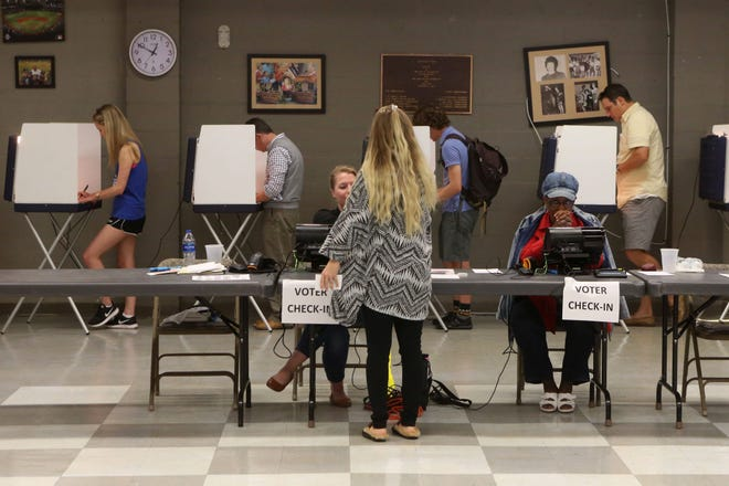 Voters throughout the Tallahassee, Florida, community used their lunch hour to vote at the Lafayette Community Center for the midterm elections Tuesday, Nov. 6, 2018.