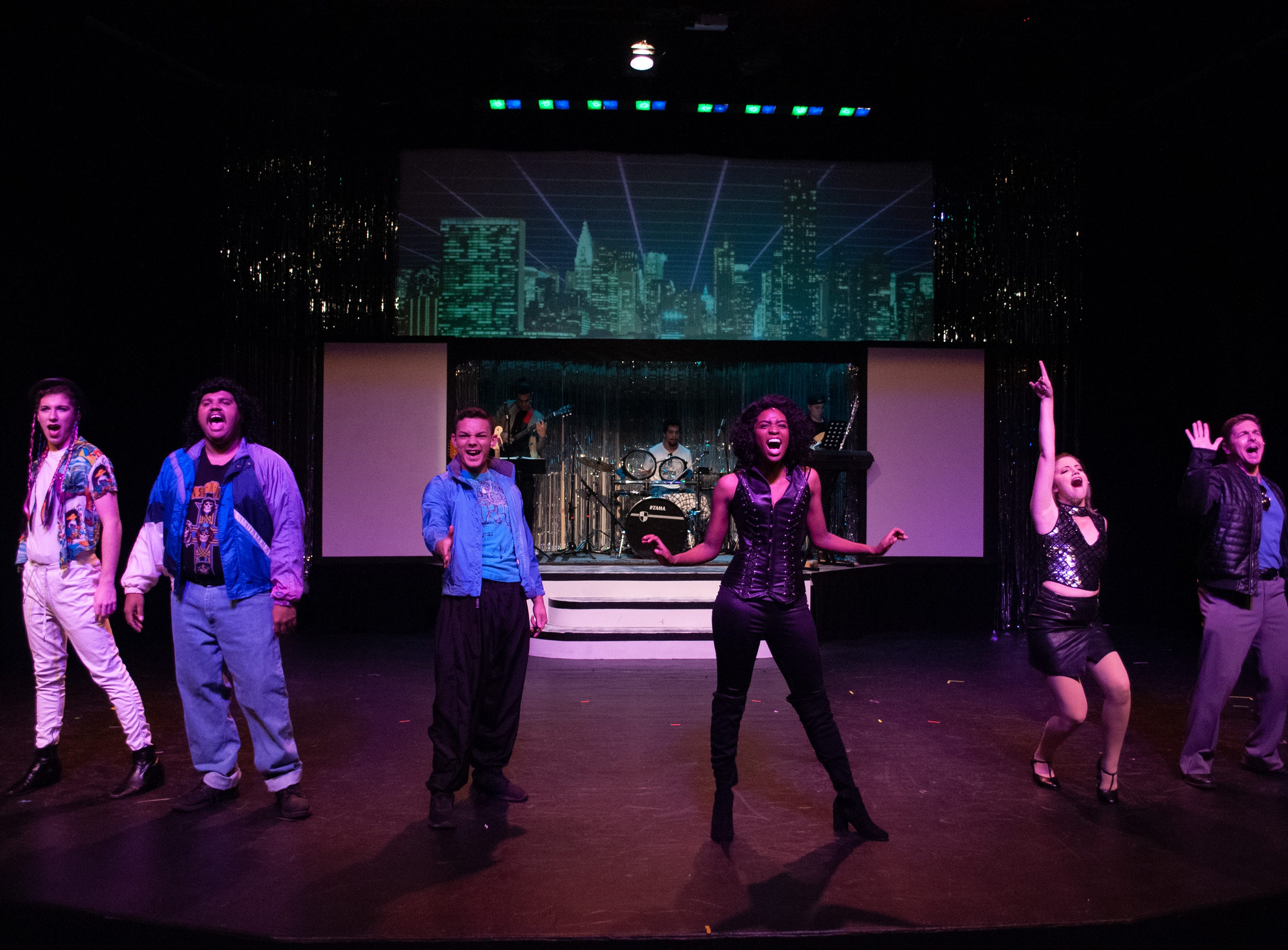 "A night on the town, with, from left, George (Spencer Lail), Sammy (Charles Burden), Robbie (Santos Sanchez), Holly (Alexis Johnson), Julia (Malia Sylvester) and Glenn (John Lipian) in Theatre Tallahassee's production of ""The Wedding Singer."""