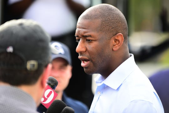 Florida Democratic gubernatorial candidate Andrew Gillum answers questions from the press after his rally at the Wakulla Community Center in Crawfordville on Monday.