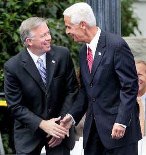 Outgoing Lt. Gov. Jeff Kottkamp and outgoing Gov. Charlie Crist bid each other farewell during Rick Scott's inauguration ceremony.