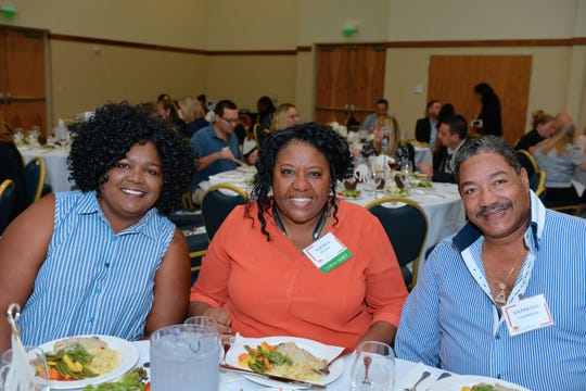 Loretta Hill, left, Angela Brazell and Anthony Chambers at the United Against Poverty of St. Lucie County fall luncheon Oct.25 at the St. Lucie Civic Center.