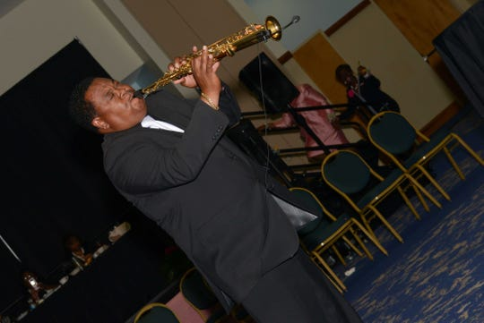 James Broxton performs the soprano saxophone during the Alpha Kappa Alpha Sorority Cluster I conference in Port St. Lucie.