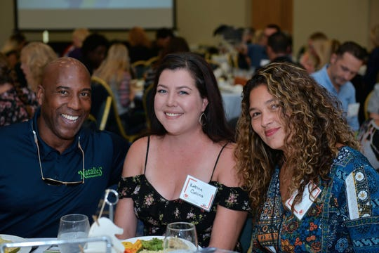 Derek Hankerson, left, Katrina Collins and Christa Stone at the United Against Poverty of St. Lucie County fall luncheon Oct.25 at the St. Lucie Civic Center.
