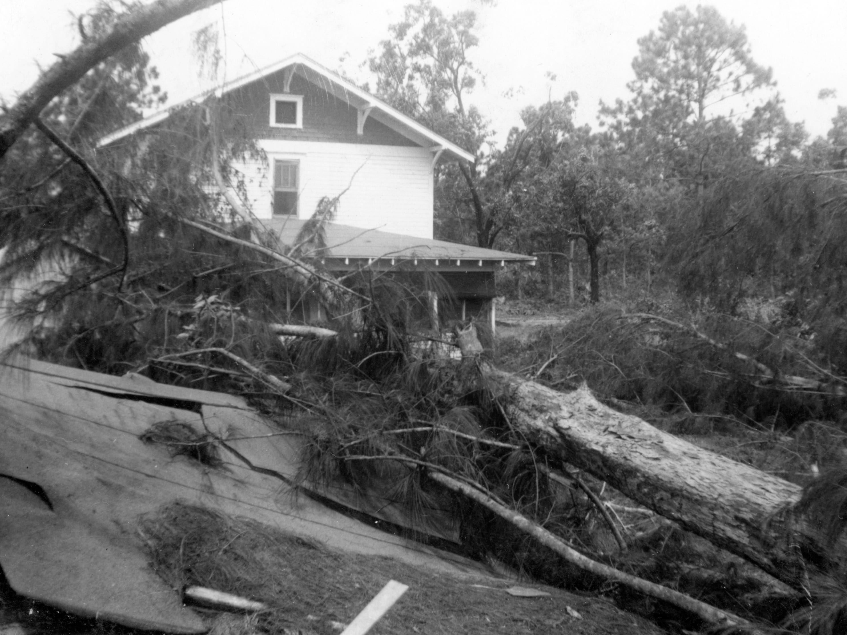 Hurricane damage is seen in 1949 to the Wodtke family home on 26th Avenue in Vero Beach. The shed in the bottom of the picture was where the male children slept.