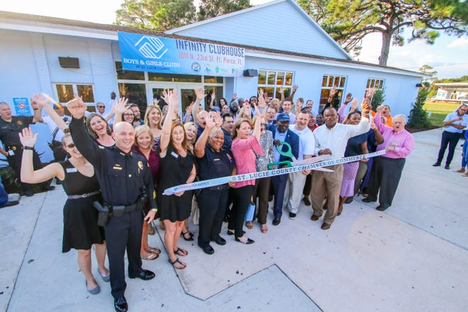 Supporters, elected officials, neighbor residents and board members of the Boys & Girls Clubs of St. Lucie County celebrate the opening of the newly remodeled Infinity Clubhouse with ceremonial ribbon cutting by the St. Lucie County Chamber of Commerce Thursday, Oct. 25. The club had been closed for over a year while going through a complete renovation.