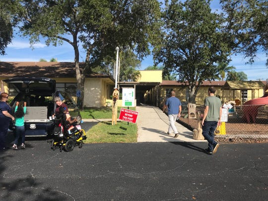 A steady stream of voters head into First United Methodist Church in Hobe Sound Nov. 6, 2018.