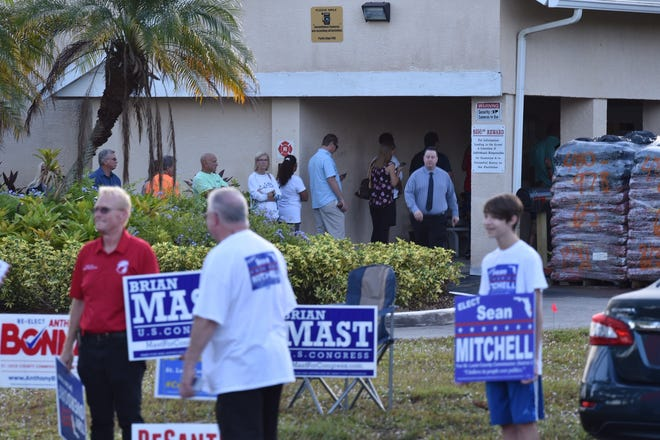 A long line of voters wait to cast their ballots at Precinct 84, Parks Edge Recreation Center in Port St. Lucie for the 2018 midterm election.