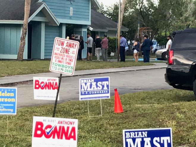 At Precinct 47 in Port St. Lucie, a line of voters stand outside the Windmill Point 1 Clubhouse at 7 a.m. in a light rain waiting to cast their ballots in the midterm election.