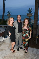 Chimp's Kitchen Event Co-Chairs Laura Guttridge, left, and Judy Van Saun, right, with Bobby Guttridge on the patio at Vero Beach Hotel & Spa for the Save the Chimps benefit Nov. 1.