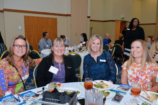 Deb Pizzimenti, left, Tracy Coggins, Table Host Dana Trabulsy and Nyla Pipes at the United Against Poverty of St. Lucie County fall luncheon Oct.25 at the St. Lucie Civic Center.