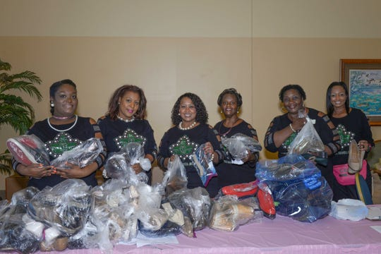 Cluster I enhanced the sorority's global initiative by contributing 972 pairs of shoes to Soles4Soles.Pictured are Eta Eta Omega Chapter members, from left, Kirsten Demps,  Jayla Brown, Jody Brown, Shearon Demps, Deborah Long and Monique Woulard with the shoes at the Alpha Kappa Alpha Sororityconference in Port St. Lucie.