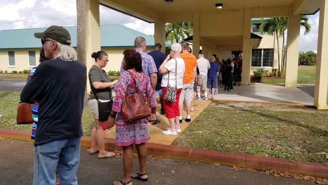 Voters at Faith Congregational Church in Port St. Lucie found long lines Tuesday morning. Lines formed early this morning, volunteers said. Voters were saying there's about a 45-minute wait because of the high volume of voters.