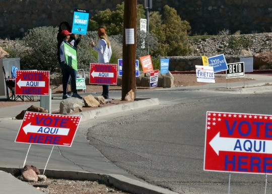 Campaign workers stand outside Fire Station 27 at 6767 Ojo de Agua Tuesday in West El Paso.