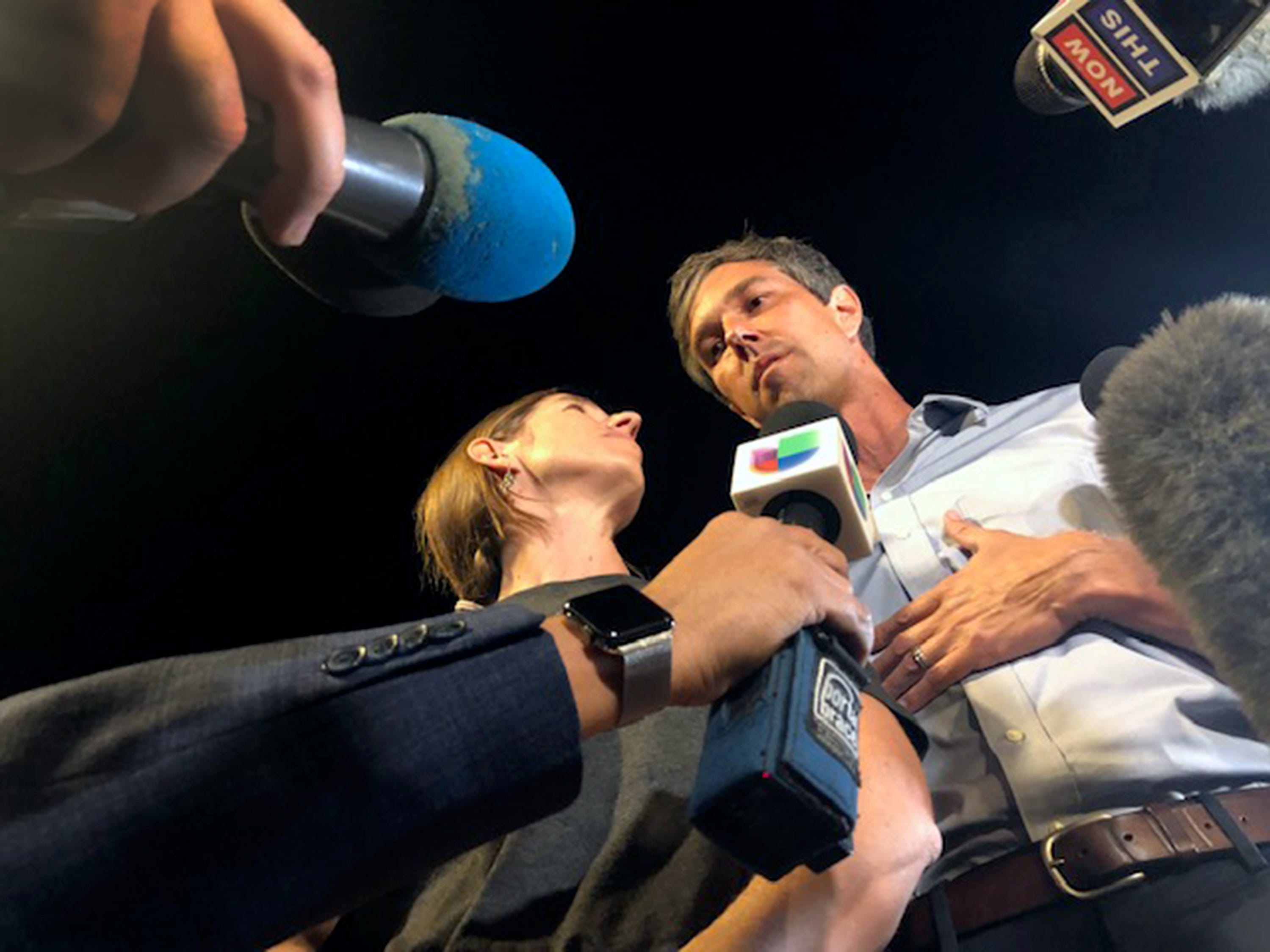 Democratic U.S. Senate candidate Beto O'Rourke and his wife Amy O'Rourke meet the media upon their arrival at Magoffin Auditorium on the UTEP campus Monday night.