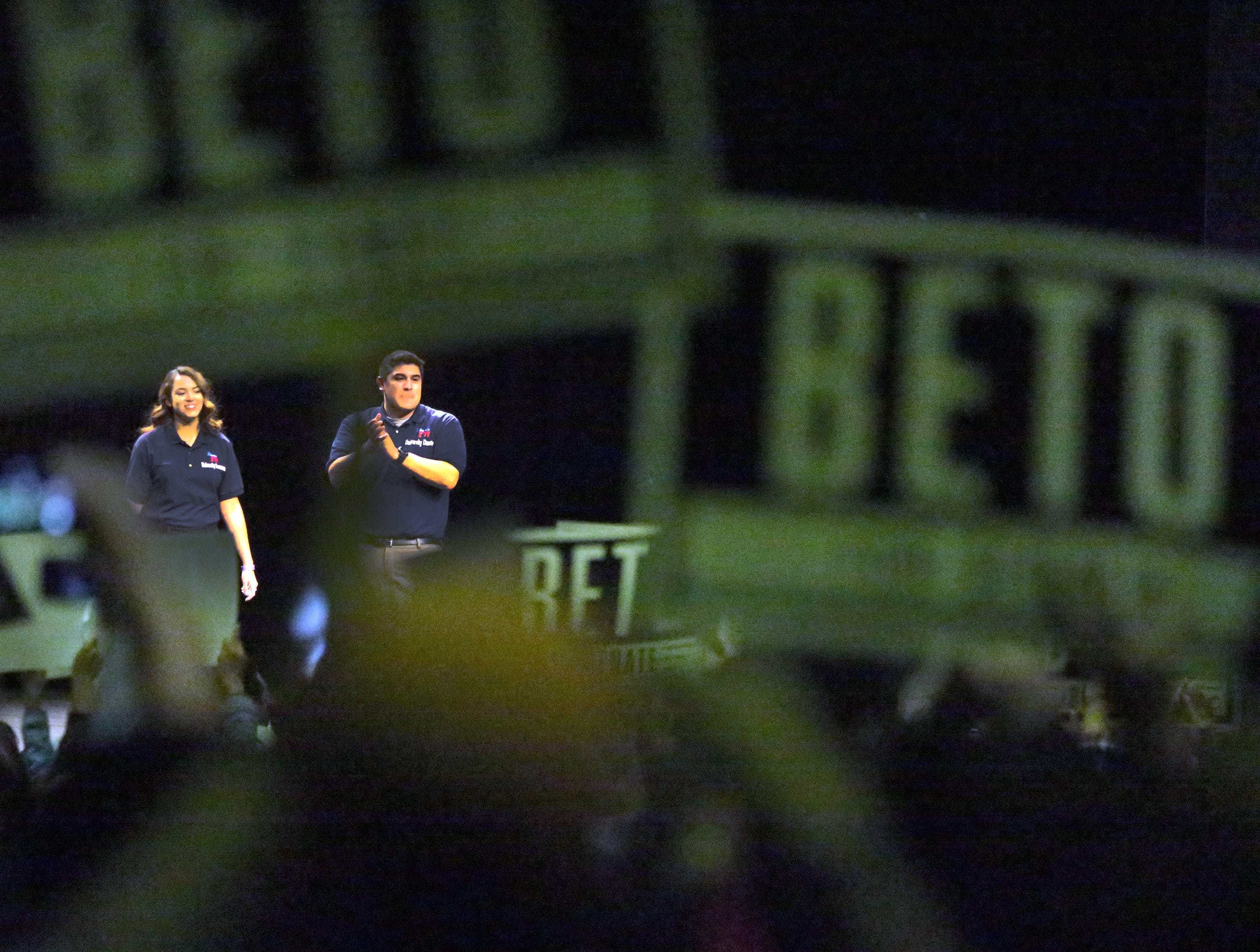 Two supporters on stage welcome Democratic U.S. Senate candidate Beto O'Rourke into Magoffin Auditorium on the UTEP campus Monday night.
