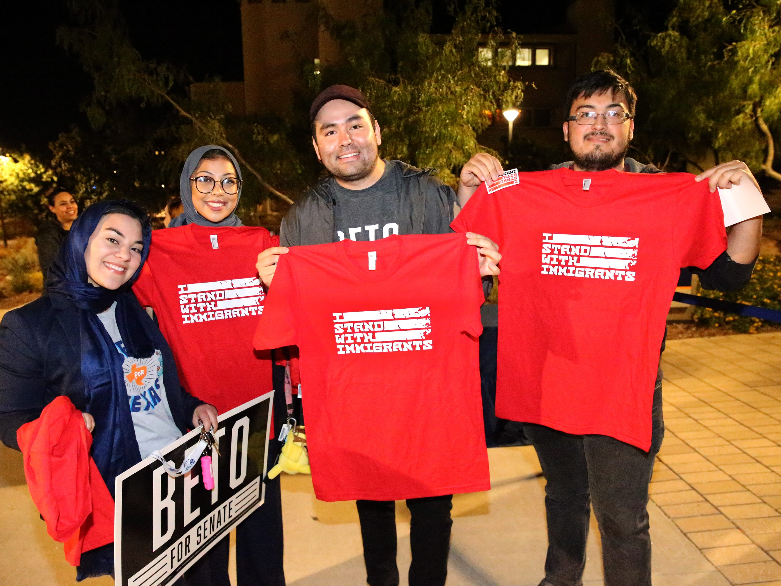 A group of El Pasoans were treated to 'I stand with immigrants' T-shirts outside Magoffin Auditorium Monday night.