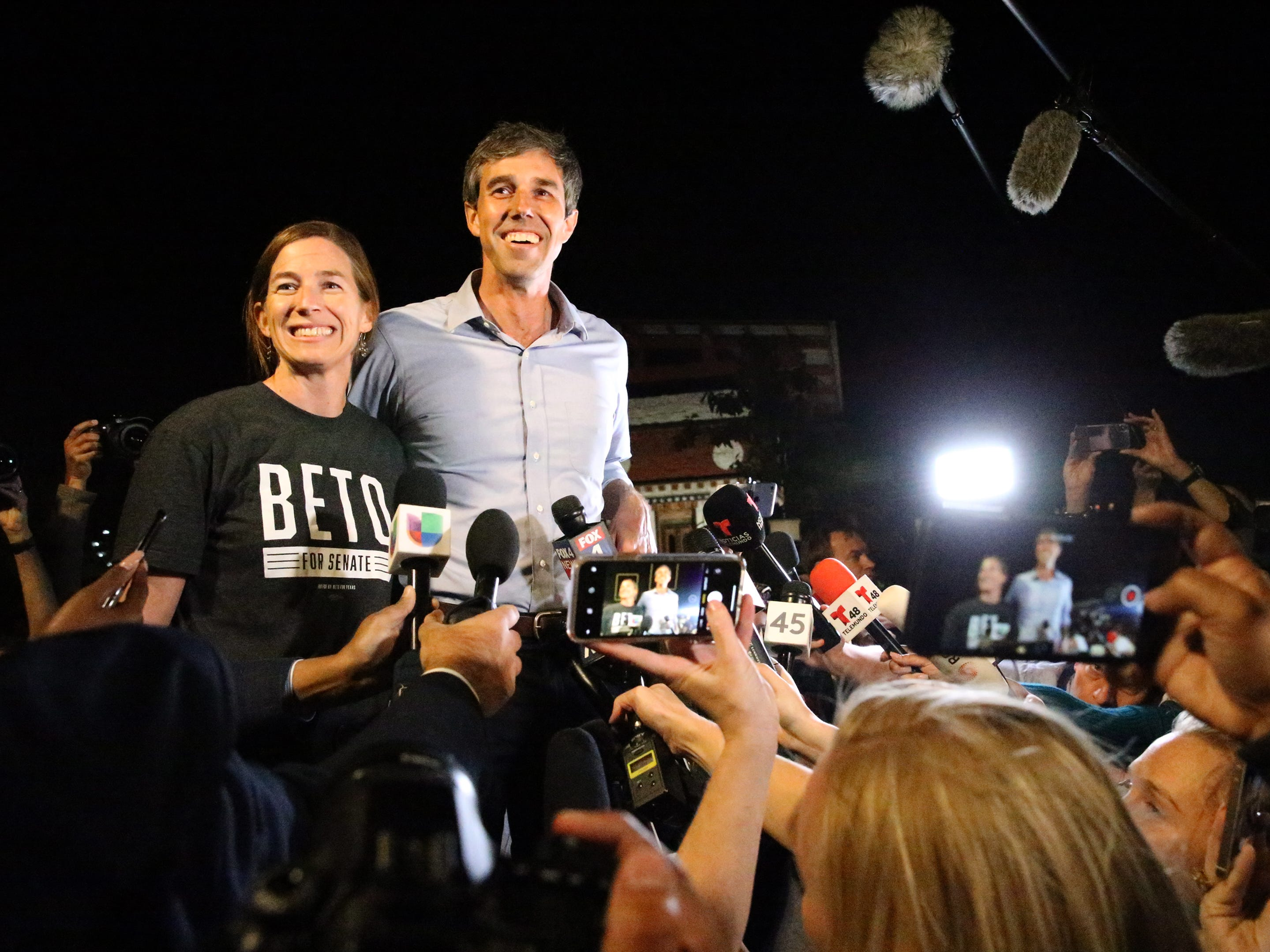 Democratic U.S. Senate Candidate Beto O'Rourke and his wife Amy speak to the media upon their arrival to Magoffin Auditorium Monday night for his final campaign rally ahead of Tuesday's midterm elections.