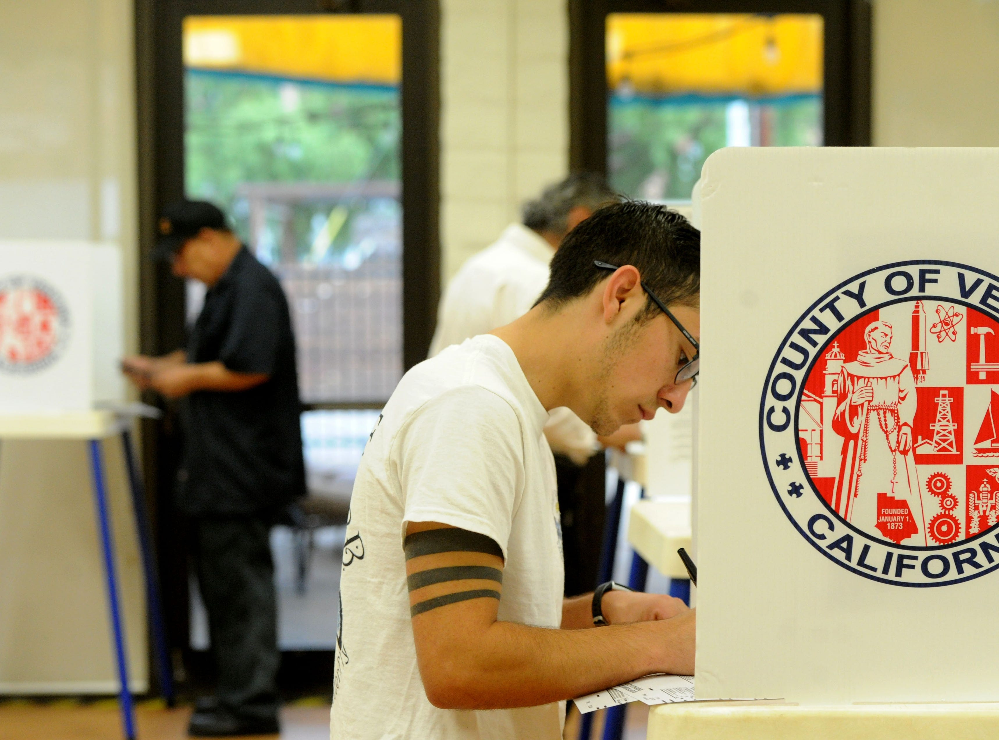 Cristian Barba votes Tuesday morning at the Ventura Avenue Adult Center. The center had a line of about 20 people.