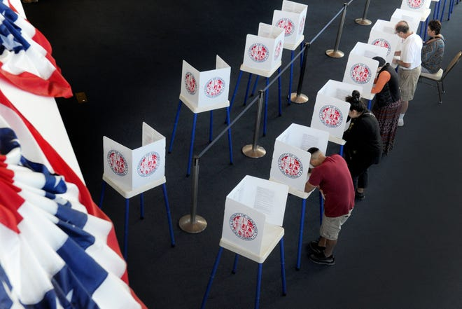 People make their ballot selections Tuesday at the Ronald Reagan Presidential Library & Museum in Simi Valley. The venue had a steady stream of voters.
